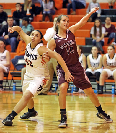 Ironton Lady Fighting Tigers' Taiya Hamlet (42) battles with Russell Lady Red Devils' Madison Darnell (10) for rebounding position during Thursday's game. Russell held off a late rally by Ironton to post a 65-54 win. (Tim Gearhart of Tim's News & Novelties, Park Ave. in Ironton)
