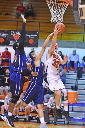Ironton Fighting Tigers' Charlie Large (32) fights the Wesley Christian defense to score inside during Friday's game of the Western & Southern Life Insurance Ironton Classic. Large had 12 points as the Fighting Tigers won 60-54. (Kent Sanborn of Southern Ohio Sports Photos)
