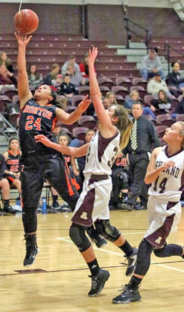 Ironton Lady Fighting Tigers' Alyssa Lewis (24) goes in for a layup as she scores two of her 11 points in a 53-25 win over the Ashland Kittens on Thursday. (Tim Gearhart of Tim's News & Novelties, Park Ave. in Ironton)