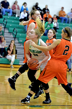 Fairland Lady Dragons' center Alesha Simpson (34) looks to go up between Ironton Lady FIghting Tigers' defenders Lexie Arden and Lydia Hannan (2) during Thursday's Ohio Valley Conference game. Fairland got the win 49-41. (Kent Sanborn of Southern Ohio Sports Photos)