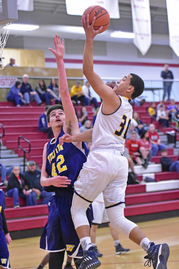 South Point Pointers' Elijah Adams drives for a layup as he scores two of his game-high 20 points in a 59-46 win over Wellston on Wednesday in the Div. III sectional tournament. (Kent Sanborn of Southern Ohio Sports Photos)