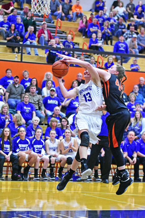 Ironton's Lexie Arden (44) gets one of her seven blocked shots as she foils Southeastern's Ella Skeens' attempt. Ironton lost 61-55 in triple overtime in the Division III district semifinals on Thursday. (Kent Sanborn of Southern Ohio Sports Photos)