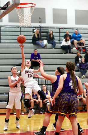 Coal Grove Lady Hornets' Emily Compliment is fouled and falls backward but still manages to get of the shot during Wednesday's Division III sectional tournament game against Lucasville Valley. The Lady Hornets won 43-22. (Tim Gearhart of Tim's News & Novelties, Park Ave. in Ironton)