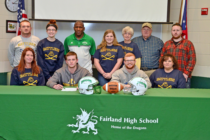 Fairland Dragons' senior football standouts Jordan Michael and Jonah Galloway signed on Wednesday to play football at Alderson-Broaddus University. Attending the signing ceremony were: seated from left to right, Jordan's mother Shana Michael, Jordan Michael, Jonah Galloway and his mother Kelli Galloway; standing left to right, Jordan's father Chuck Michael, sister Allie Michael, Fairland head coach Melvin Cunningham, Jonah's sister Rylee Galloway, grandparents Donna and Jerry Galloway, and cousin Seth Galloway. (Kent Sanborn of Southern Ohio Sports Photos)