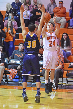 Ironton Fighting Tigers' Trevor Hacker (24) takes a 3-pointer over the outstretched arms of South Point Pointers' Elijah Adams during Friday's game. Ironton won 50-36. (Kent Sanborn of Southern Ohio Sports Photos)