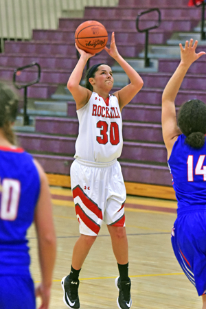 Rock Hill Redwomen guard Jill Hairston pulls up and hits a 3-pointer as she scores 10 points in 54-39 Division III sectional tournament game over Northwest on Wednesday. (Kent Sanborn of Southern Ohio Sports Photos)