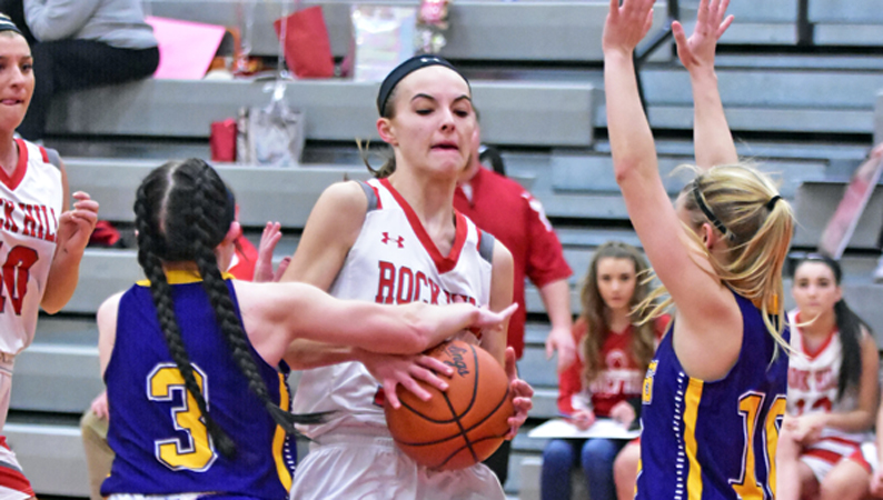 Rock Hill Redwomen's Caitlynn Meadows looks to split St. Joseph defenders Kaitlyn Sheridan (3) and Morgan Turner (right) during Wednesday's game. Rock Hill won 49-23. (Kent Sanborn of Southern Ohio Sports Photos)