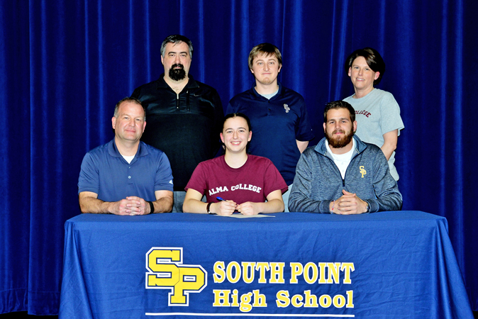 South Point Lady Pointers' senior soccer standout Camera Stevens signed to play at Alma College in Alma, Michigan. Attending the signing ceremony were: seated left to right, travel coach Scott Maddox, Camera, and coach Drew Lynd; standing left to right, father Robert Stevens, coach Daniel Bailey, and mother Margie Henry. (Kent Sanborn of Southern Ohio Sports Photos)