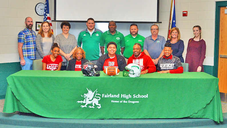 Fairland Dragons' senior lineman Michael Tubbs signed a letter-of-intent Wednesday to play football at Kentucky Christian University. Attending the ceremony were: seated left to right, Melia Tubbs, grandmother Lacora Ford, Michael, father Michael Tubbs Sr., and mother Melissa Tubbs; standing left to right, Carson Bailey, Julia Mathisen, Cyndi Keith, athletic director Jeff Gorby, Fairland head coach Melvin Cunningham, assistant coaches Mark Hinkle and Clayton Dement, Jennifer Bailey and Basil Bailey. (Tony Shotsky of Southern Ohio Sports Photos)