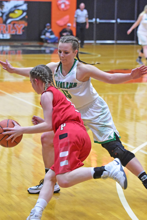 Fairland Lady Dragons' Kelsie Warnock (13) defends against Piketon Lady Red Streaks' Avery Reuter (with ball) during Monday's Division III district semifinal game at Waverly. Fairland pulled away in the third quarter to a 51-30 win. (Kent Sanborn of Southern Ohio Sports Photos)