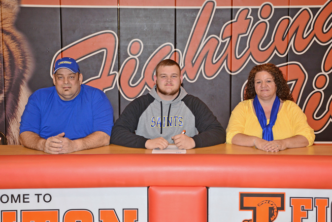 Ironton Fighting Tigers' first team All-Ohio lineman Tyler Webb signed with Limestone College on Wednesday to play football for the program. Attending the signing ceremony were, seated left to right, his father Charles Webb, Tyler, and his mother Nina Webb. (Kent Sanborn of Southern Ohio Sports Photos)