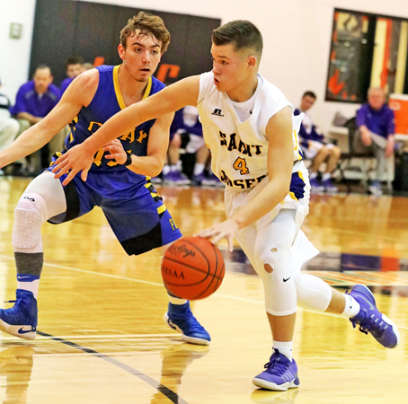 St. Joseph Flyers' guard Isaac Whaley (4) pushes the ball up the court during Saturday's game against Racine Southern. The Flyers couldn't hold their lead in a 61-52 loss. (Tim Gearhart of Tim's News & Novelties, Park Ave. in Ironton)