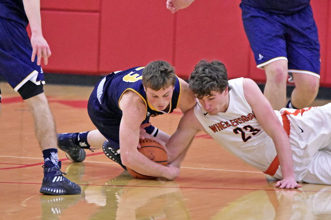 South Point Pointers' Jared Whitt (left) and Wheelersburg Pirates' Kaden Coleman (right) battle for a loose ball during Saturday's Division III sectional championship game. The Pointers beat the Pirates 70-63 and will play Sunday in the district tournament at Athens. (Kent Sanborn of Southern Ohio Sports Photos)